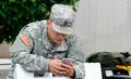 Soldier Texting Stock Photos - 64693083