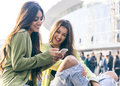 Two Young Women Having Fun In The City Center Stock Photos - 64714983