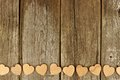 Valentines Day Wooden Hearts Bottom Border On Rustic Wood Stock Photos - 64740213
