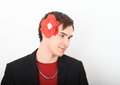 Man With Paper Rose In Hair Stock Photos - 64757083