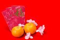 Mandarin Oranges And Red Packets With Chinese Good Luck Characte Royalty Free Stock Image - 64774646