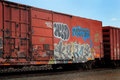 Graffiti On A Red Railroad Car Stock Images - 64814944