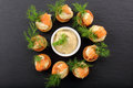 Appetizer Puff Pastry With Dill Dip And Salmon On Stone Tray Royalty Free Stock Photos - 64821908