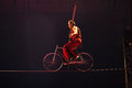 High Wire Circus Act With Bike Royalty Free Stock Photos - 64826928