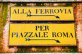 Alla Ferrovia And Piazzale Roma Direction Sign In Venice Stock Images - 64829894