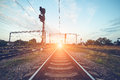 Train Platform And Traffic Light At Sunset. Railroad. Railway St Royalty Free Stock Image - 64838316