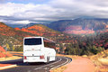 White Tourists Bus Cornering In Sedona Stock Image - 64851661