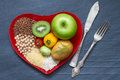 Health Food On A Red Heart Plate Diets Abstract Still Life Stock Image - 64857961