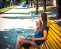 Young Girl Student Sitting On Yellow Bench Stock Photos - 64862933