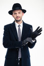 Attractive Gentleman Putting On Black Leather Gloves Royalty Free Stock Image - 64865846