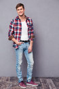 Full Length Potrait Of Charming Happy Man In Plaid Shirt Stock Photos - 64869453