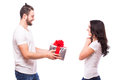 Happy Young Couple With Valentine S Day Present Isolated On A White Background. Stock Photography - 64873682