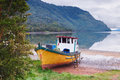 Old Boat Anchored On The Beach Of The Fjord Of Puyuhuapi, Patago Royalty Free Stock Image - 64879766