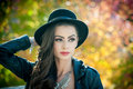 Beautiful Woman With Black Hat Posing In Autumnal Park. Young Brunette Spending Time During Autumn In Forest Royalty Free Stock Image - 64883106