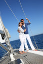 Happy Young Couple On A Sailing Boat Stock Images - 64884864