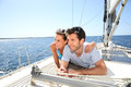 Young Couple Relaxing On Sailing Boat S Deck Royalty Free Stock Photos - 64886568