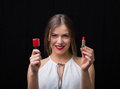 Woman With A Nail Polish And A Red Lipstick Stock Photo - 64893530