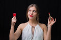 Woman With A Nail Polish And A Red Lipstick Stock Image - 64894381