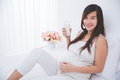 Beautiful Pregnant Asian Woman Holding A Glass Of Milk, Smiling Royalty Free Stock Photos - 64905378
