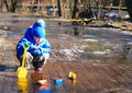 Child Playing With Paper Boats In Spring Water Royalty Free Stock Image - 64914276