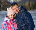 Father With Daughter Enjoying Winter Vacations Stock Photography - 64916402
