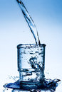 Clean Water Overflows The Glass Beaker Royalty Free Stock Photo - 64923715