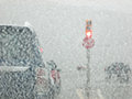 Driving In A Snow Storm Stock Images - 64934114