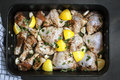 Preparing Roast Chicken With Lemon Garlic And Thyme Royalty Free Stock Photos - 64946478