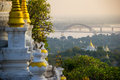 The Bridge Across Irrawadee River And The Old Pagodas In Sagaing Area. Mandalay. Myanmar Stock Photo - 64948360