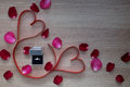 Wedding Ring And Two Red Heart Ribbon With Pink And Red Rose Pet Stock Image - 64951271