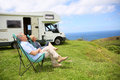 Senior Couple Relaxing On The Seaside Royalty Free Stock Photo - 64952855