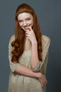 Portait Of A Smiling Cute Redhead Woman Stock Photos - 64961993