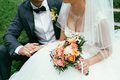 Groom Holding A Bride Hand With Weding Bouquet On Wedding Day Royalty Free Stock Photo - 64963965