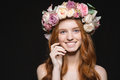 Smiling Redhead Woman With Wreath From Flowers On Head Royalty Free Stock Photo - 64980785