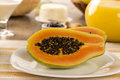 Breakfast Table With Papaya And Coffee Royalty Free Stock Images - 64989049