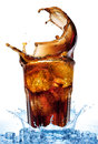 Splash From Ice Cubes In A Glass Of Cola, Isolated On The White Background Royalty Free Stock Photography - 64989957