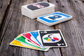 Uno Card Game On Wood Table Stock Photography - 64991182