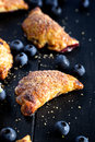 Blueberry Hand Pies On Black Wooden Table Stock Photography - 64992032