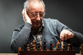 Senior Man Thinking About His Next Move In A Game Of Chess Royalty Free Stock Images - 64993489