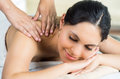 Hispanic Brunette Model Getting Massage Spa Royalty Free Stock Photography - 65000517