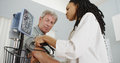African Woman Doctor Checking Patient S Blood Pressure Stock Photo - 65046190