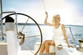 Beautiful Sexy Young Blonde Woman, Riding A Boat On The Water, Itinerary, Beautiful Makeup, Clothing, Summer, Sun, Perfect Body Fi Royalty Free Stock Photo - 65049315
