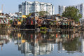 Views Of The City S Slums From The River (in The Background And In Reflection Of The New Buildings) Royalty Free Stock Image - 65113236