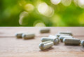 Herbal Capsules On Wooden Table Stock Images - 65114694