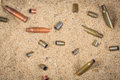 Cartridge Cases On The Sand Stock Photography - 65120712