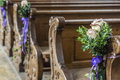 Church Pew Details With Floral Wedding  Decoration Stock Photos - 65133313