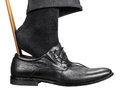 Man Dons Black Shoe With Shoehorn Isolated Royalty Free Stock Images - 65135929