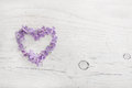 Heart Of Violet Or Blue Lilac Blossom On White Shabby Wooden Stock Photo - 65148070