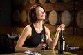 Laughing Fun Dating Woman Date Night Glass Of Wine At Winery With Barrels In Background Royalty Free Stock Photography - 65150167