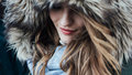 Young Woman With Fur Hood Stock Photos - 65169073